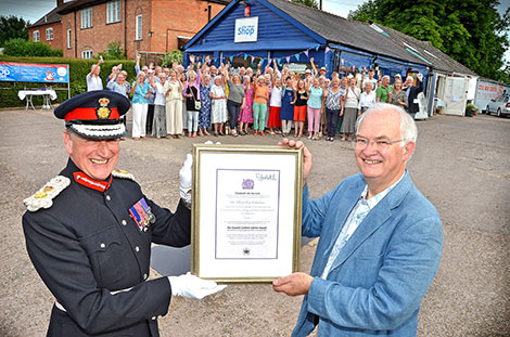 The Lord-Lieutenant presenting the Queen's Award for Voluntary Service to John Eaton, Chairman of The Village Shop in Feckenham.  Photo with kind permission of the Redditch Standard.